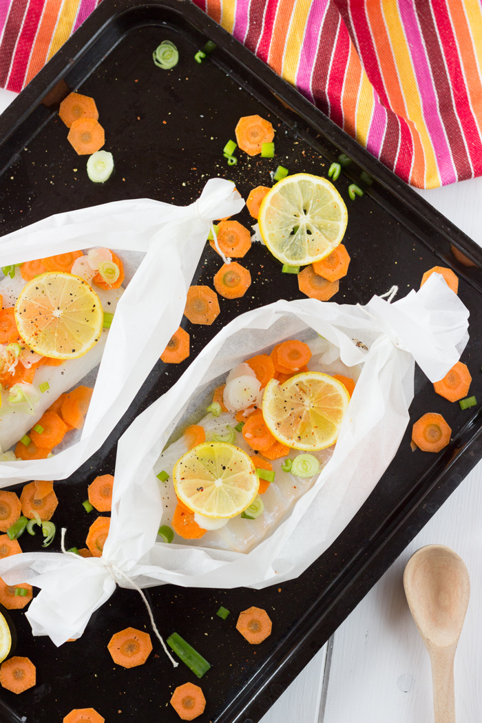 Cod en papillote with lemon and spring onions