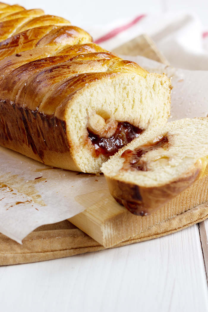 English brioche with strawberry jam, dried grapes and flaked almonds