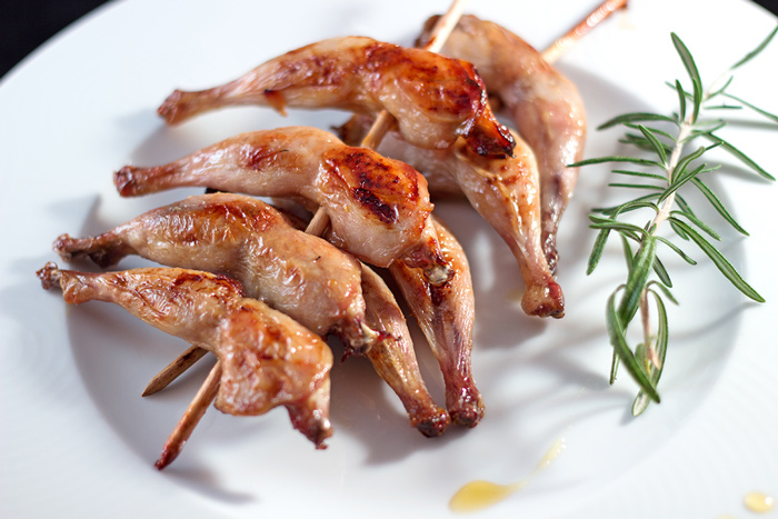 Honey glazed quail leg skewers