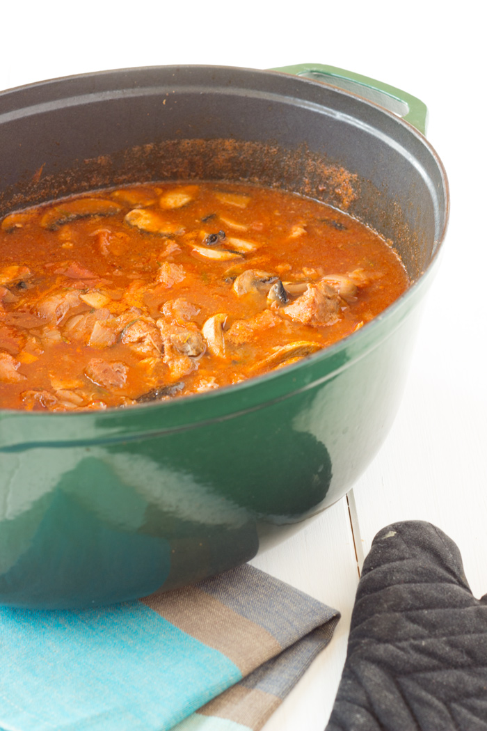 Pork stew with mushrooms and tomato sauce
